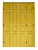Isoleert gele deuren stock foto