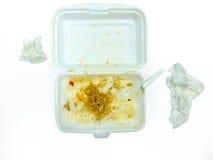 Isoleert van schuimdozen met over verlaten schroot van het eten en vuil weefsel Royalty-vrije Stock Afbeeldingen