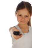 Isolerad ändrande kanal för ung flicka Royaltyfri Foto
