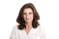Isolerad allvarlig och tvivelaktigt äldre kvinna i mellersta ålder Fotografering för Bildbyråer