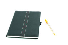 isolerad anteckningsbokpenna Arkivbilder