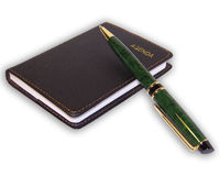 isolerad anteckningsbokpenna Arkivfoton