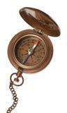 isolerad antik kompass Arkivfoto