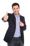 Isolerad attraktiv lyckad le affärsman med tummen upp arkivfoto