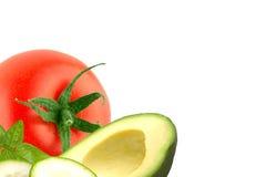 Isolerad avokado, gurka och tomat på vit Fotografering för Bildbyråer