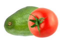 Isolerad avokado och tomat på vit bakgrund Royaltyfria Foton