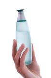 isolerad doft för flaskkvinnlighand holding Arkivfoto