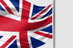 Isolerad Förenade kungariket flagga som vinkar realistiskt Förenade kungariket tyg för 3d Arkivfoto