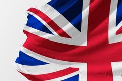 Isolerad Förenade kungariket flagga som vinkar realistiskt Förenade kungariket tyg för 3d Arkivbild