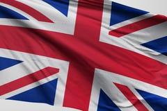 Isolerad Förenade kungariket flagga som vinkar realistiskt Förenade kungariket tyg för 3d Royaltyfri Fotografi