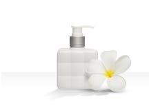 Isolerad fyrkantig vit bakgrund för för flasktvål och blomma Royaltyfria Bilder