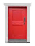 Isolerad gammal liten träröd dörr. Arkivfoto