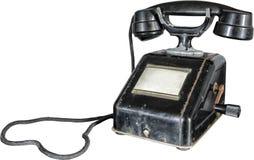 Isolerad gammal svart rostig telefon med handtaget Arkivbild