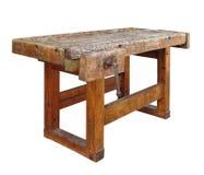 Isolerad gammal träarbetsbänk. arkivbild