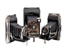 Isolerad grupp av photocamera tre på medelformat Royaltyfri Bild