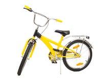 Isolerad gul cykel Arkivbild