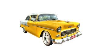 Isolerad gul 50-tal Chevy på vit bakgrund Arkivbild