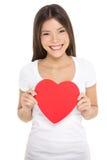 Isolerad hållande hjärta för valentindagkvinna Arkivfoton