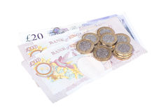 Isolerad hög av pundsedlar och mynt Royaltyfria Foton