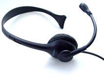 isolerad hörlurar med mikrofon Arkivfoton