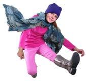 Isolerad höststående av barnet med att hoppa för hatt, för halsduk och för kängor Arkivbilder