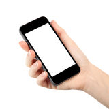 Isolerad kvinnahand som rymmer telefonen Royaltyfria Foton