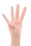 Isolerad kvinnlig hand som visar numret fyra Arkivfoton