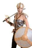 Isolerad kvinnlig krigare med hjälmen och skölden royaltyfri fotografi