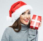 Isolerad kvinnlig stående för juljultomten hatt santa kvinna Chri Arkivbild