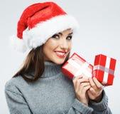 Isolerad kvinnlig stående för juljultomten hatt santa kvinna Chri Royaltyfri Fotografi