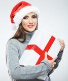 Isolerad kvinnlig stående för juljultomten hatt santa kvinna Chri Arkivbilder