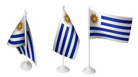 Isolerad liten Uruguay för skrivbord som 3 flagga vinkar den realistiska Uruguay skrivbordflaggan för 3d Royaltyfri Bild