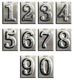 isolerad metall numrerar typ Arkivfoto