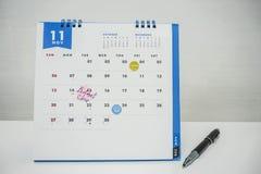 Isolerad November kalender med möte, utbildning och budgeten Arkivfoto