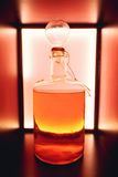 Isolerad röd lantlig flaska av sur likör Nationella drinkar Royaltyfria Bilder