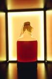 Isolerad röd lantlig flaska av sur likör Nationella drinkar Fotografering för Bildbyråer