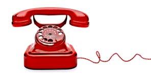 Isolerad röd telefon arkivbilder