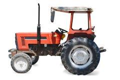 Isolerad röd traktor Arkivbild
