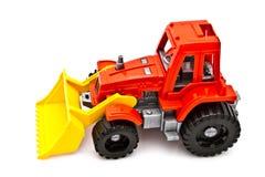 isolerad röd traktorwhite Arkivbild