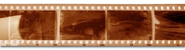 Isolerad ram av den gamla fotografiska filmen Arkivfoto