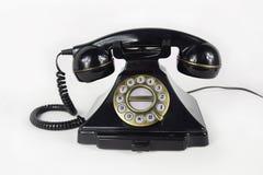 Isolerad Retro svart telefon - arkivfoto