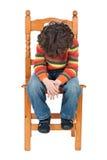 isolerad SAD sitting för stol barn arkivfoto