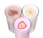 Isolerad samling för uppsättning för glass för milkshakechokladanstrykning arkivfoto