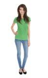 Isolerad slank ung kvinna i blått och gräsplan i fors för hel kropp Fotografering för Bildbyråer
