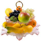 Isolerad ställning med plast- frukter Arkivfoton