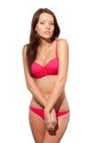 Isolerad stående av kvinnan som slitage den rosa bikinin Fotografering för Bildbyråer