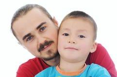 Isolerad stående för fader och för son tillsammans Arkivfoton