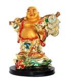 Isolerad statyett av den guld- Buddha Fotografering för Bildbyråer