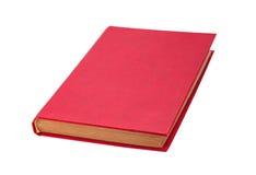 Isolerad stängd röd bok Arkivbilder