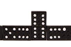 isolerad svart domino parts följdwhite Arkivfoto